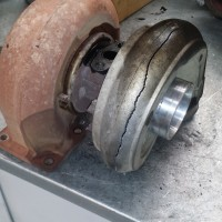 Burst compressor wheel failure, caused by a split intercooler pipe.